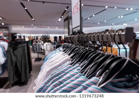 Women clothes in fashion store. Shopping mall. Women fashion shopping concept. #1319673248