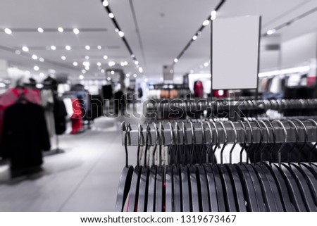Women clothes in fashion store. Shopping mall. Women fashion shopping concept. #1319673467
