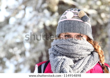 Women covering her face with scarf to keep warm
