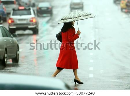 women cross the street on the rain - stock photo