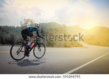 Women cycling mountain road bike in the morning