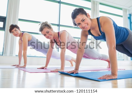 Women doing pushups at the gym