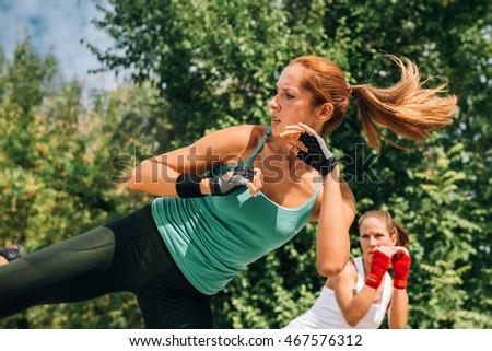Women doing TaeBo side kicks
