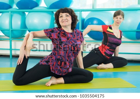 Women doing yoga exercise in the gym