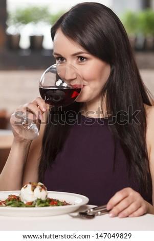 Women drinking wine. Beautiful mature women drinking wine in restaurant
