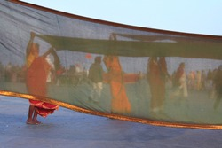 women drying sarees in Gangasagar, West Bengal, india