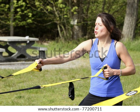women exercising with sports equipment outdoors