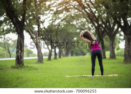 Women exercising.Women exercising in sunny bright light. #700096255