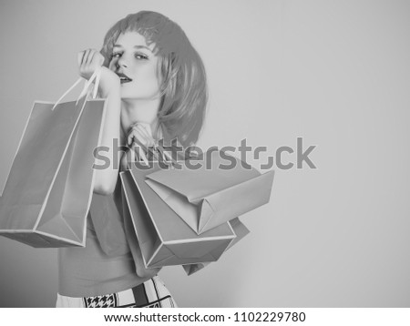 Women face skin care. Portrait women face in your advertisnent. Girl wearing red wig and fashionable clothes. Woman with shopping bags. Holidays celebration concept. Sale and black friday. Fashion #1102229780