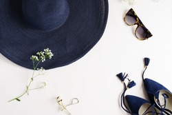Women  fashion background. blue high heel shoes and accessories hat , sunglasses top view on light background.