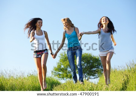 women fun on grass field