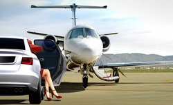 Women getting ready to boarding private jet at airfield