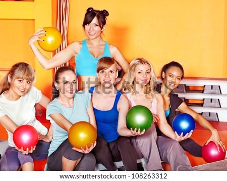 Women group in aerobics class.  Fitness ball.