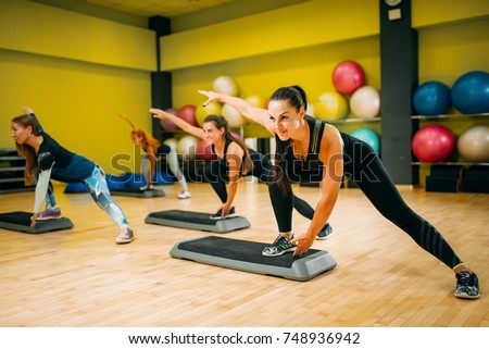 Women group on step aerobic training