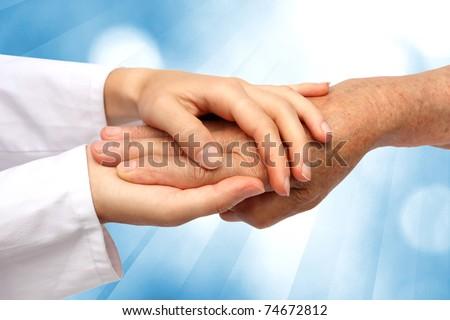 Women hand helping senior
