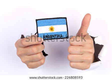 Women Hand Holding Argentina Flag isolated on white #226808593