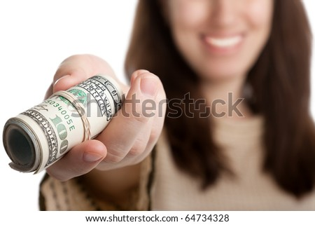 Women hand holding rolled up paper dollar currency