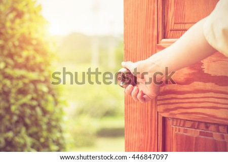 Women hand open door knob or opening the door. #446847097