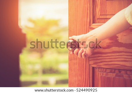 Women hand open door knob or opening the door. #524490925