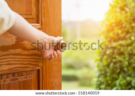 Women hand open door knob or opening the door. #558140059