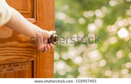 Women hand open door knob or opening the door. #558907405