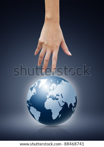 Women hand  pointing down to the globe