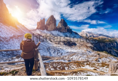Women hand using a compass in the mountains, travel concept. Hand with compass at mountain road, background of mountains in summer, point of view. #1093578149