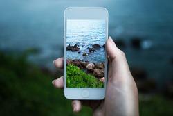 Women hand using smart phone with take photo