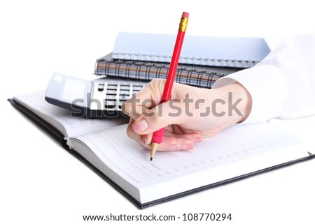 women hands with pencil, notebook and Calculator isolated on white