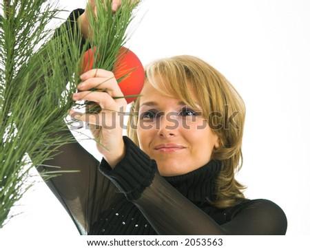 Women hanging ornaments on Christmas tree