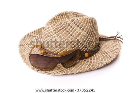 Women hat and sun glasses isolated on white