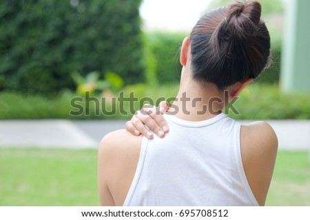 Women have neck pain, shoulder pain, at the park health concept. #695708512
