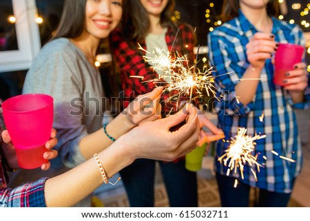Women having party with bengal light #615032711