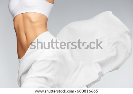 Women Health. Beautiful Healthy Woman With Fit Slim Body, Silky Smooth Soft Skin In White Bikini Underwear. Closeup Of Textile Flying On Perfect Female Body Shape. Body Care Concept. High Resolution #680816665