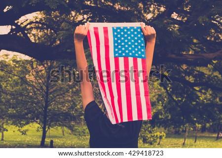 women holding american flag in...