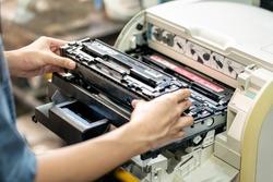 Women holding Laser toner cartridge ,replacing toner in laser printer at office. Repairs and Maintenance Laser printers concept
