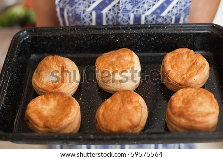 Women holding tray with delicious pastry