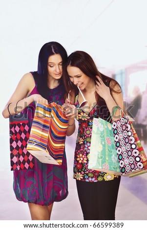 women in a shopping center