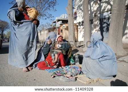 Women in burka begging
