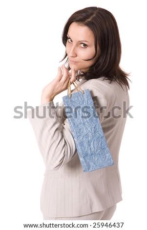 women in grey suit keeping blue present bag