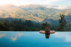 Women in infinity pool at the Knuckles Mountains in Kandy Sri Lanka