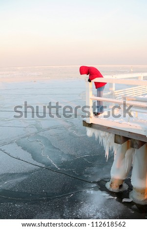 Women in red. Pier, jetty  on the sea - ice - floe. Poland, Gdynia