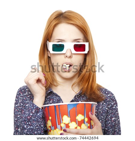 Women in stereo glasses eating popcorn. Studio shot. - stock photo
