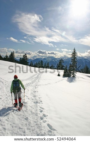 Women in the winter snow shoe hiking.