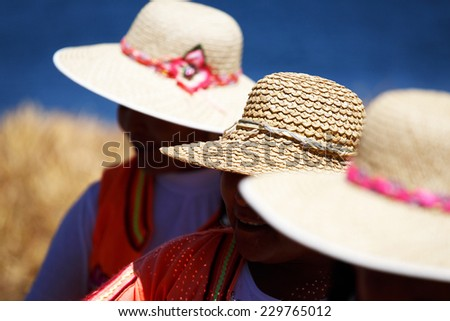 Women in traditional clothes on Island Uros, Lago Titicaca, Puno, Peru #229765012