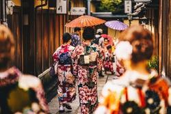 Women in traditional japanese kimonos walking in Kyoto, Japan