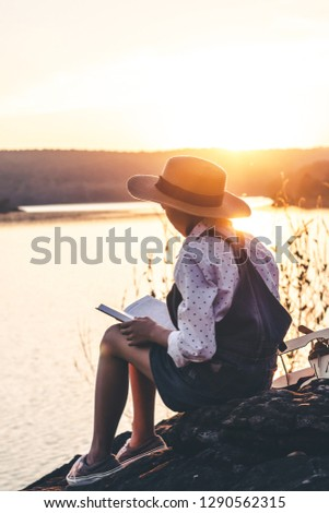 Women in winter sit read favorite book in the holiday, Concept girl reading a book. Foto stock ©