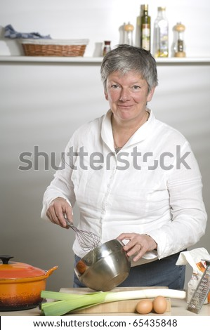 Women is using a mixer in the kitchen