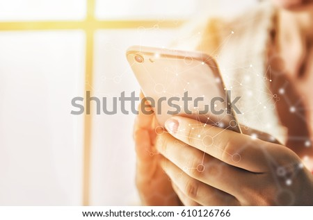 Women is using phone. Concept of young people are working  with mobile devices. Close up.