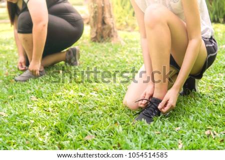 women joggers tying shoelaces. #1054514585